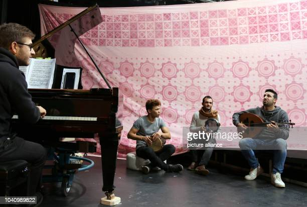 The musicians Mahdi Hussaini Ghandi Aljrf and Basel Alkatrib practice together at the theatre PlauenZwickau in Plauen Germany 19 January 2017 They...