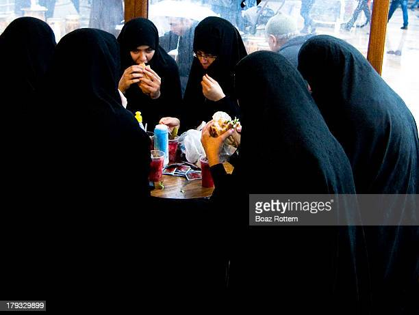 The Muslim sisterhood enjoying fish sandwiches by the Galata bridge in Istanbul.