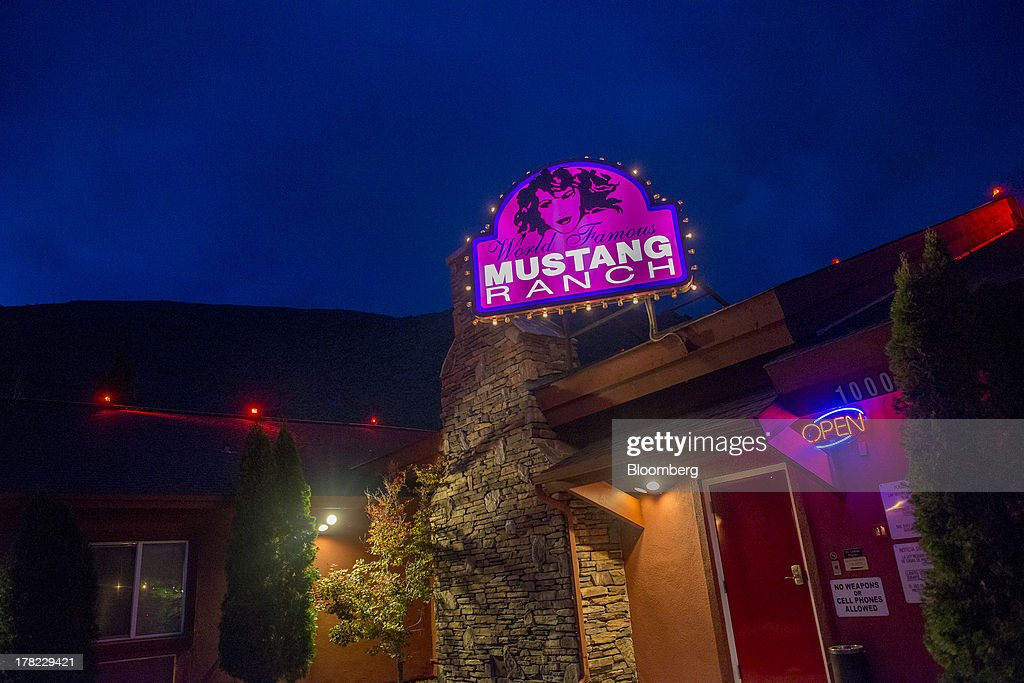 The Mustang Ranch brothel sign is displayed at the entrance to the brothel in Sparks, Nevada, U.S., on Wednesday, Aug. 21, 2013. Growing use of the Internet to arrange liaisons with prostitutes and decreased patronage by truckers squeezed by rising fuel costs are also hurting houses of prostitution that took root during Nevada's mid-1800s silver-mining boom, George Flint, lobbyist for the Nevada Brothel Owners Association and brothel managers say. Photographer: David Paul Morris/Bloomberg via Getty Images