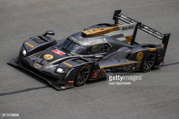 The Mustang Sampling Racing Cadillac DPiVR of Filipe Albuquerque Joao Barbosa and Christian Fittipaldi races during the Rolex 24 at Daytona on...