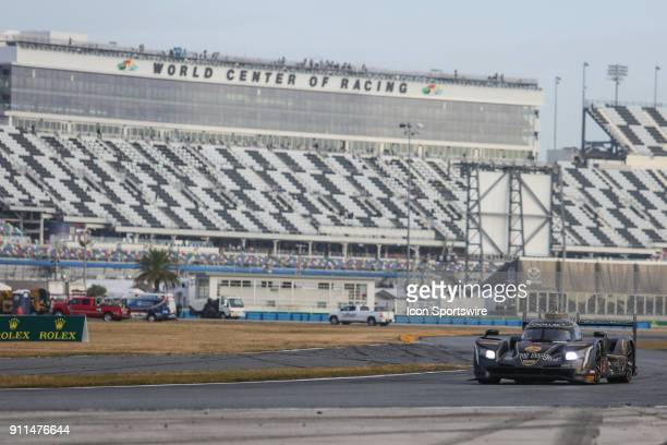 The Mustang Sampling Racing Cadillac DPiVR of Filipe Albuquerque Joao Barbosa and Christian Fittipaldi races into a turn during the Rolex 24 at...