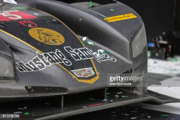 The Mustang Sampling Racing Cadillac DPiVR of Filipe Albuquerque Joao Barbosa and Christian Fittipaldi sits in Victory Lane following the Rolex 24 at...