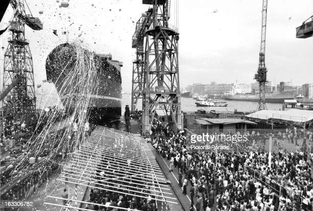 The Mutsu, first atomic powered ship, sliding down the ways during a celebration in Japan, 1969.