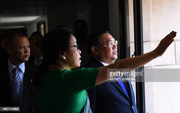 The Myanmarese Minister of Foreign Affairs U Wunna Maung Lwin and the Dean of the Foreign Services Institute Nengcha Lhouvum walk through the Indian...