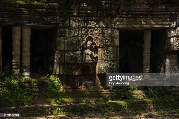 The mystery of ancient Khmer kingdom the Apsara decoration in Ta prohm temple, Cambodia.