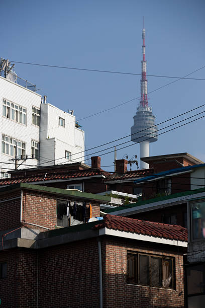 The N Seoul Tower is seen behind houses in the Haebangchon area of Yongsan  district in