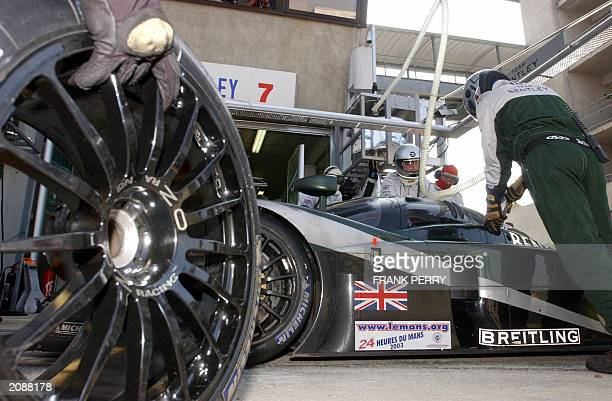 The N*7 Bentley of crew Danish Tom Kristensen Italian Rinaldo Capello and Briton Guy Smith is being refuelled during a stop in the pits to take the...