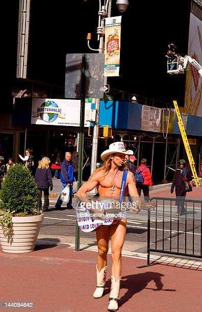 The Naked Cowboy Performing With Guitar In Times Square In New York City
