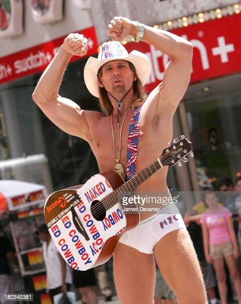 The Naked Cowboy performs in Times Square outside MTV studios on August 4 2008 in New York City