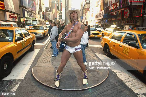 The Naked Cowboy sings in Times Square on a cold fall day New York New York October 23 2002