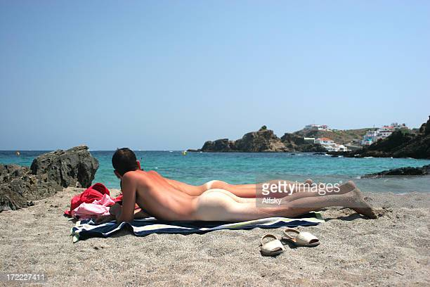 the naked truth - naturalist beach stock photos and pictures