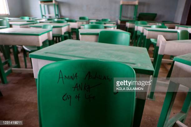 The name of a student is written on a chair in a deserted classroom at the Government Girls Secondary School, the day after the abduction of over 300...