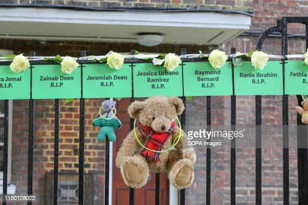 The names of people who lost their lives, hung from railings on a block of flats during the commemoration. The Grenfell Tower second anniversary...