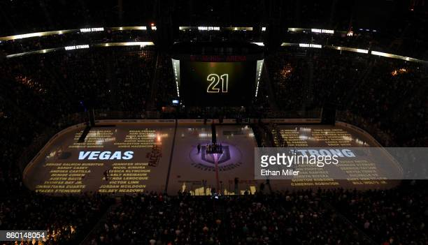 The names of the 58 people killed at the Route 91 Harvest country music festival are projected on the ice as the scoreboard counts 58 seconds of...