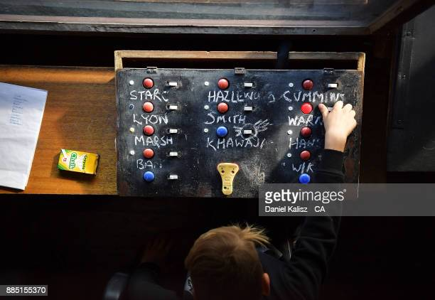 The names of the Australian team can be seen on scorekeeping equiptment from inside the old scoreboard during day three of the Second Test match...