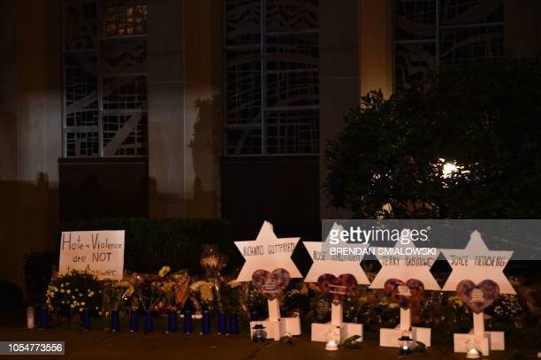 The names of the victims are displayed at a memorial on October 28 2018 outside the Tree of Life synagogue after a shooting there left 11 people dead...