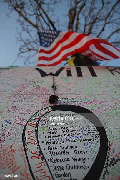 The names of the victims are written on a memorial setup across the street from the Century 16 movie theatre on July 26 2012 in Aurora Colorado...