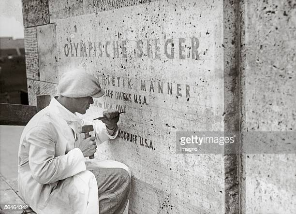 The names of the winners of the 11th Olympic Games are being chiseled into the 'Honor Board' of the marathon gate Photography Berlin Germany 1936...