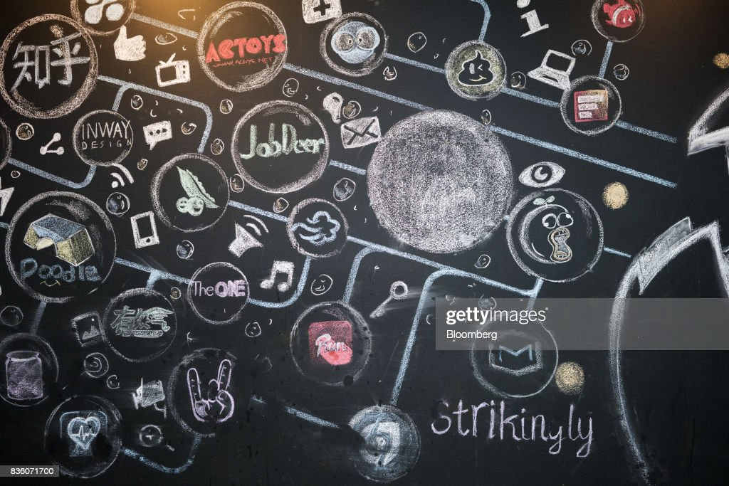 The names of various startup companies in which Sinovation Ventures have invested are displayed on a chalk board at the venture's headquarters in Beijing, China, on Tuesday, Aug. 15, 2017. SinovationVentures' latest growing endeavor, an in-house AI Institute, has about 30 full-time employees with plans to grow headcount to about a hundred within the year. Photographer: Giulia Marchi/Bloomberg via Getty Images
