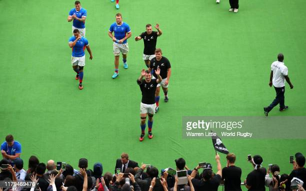 The Namibia players acknowledge the crowd as they leave wearing All Black jerseys after the Rugby World Cup 2019 Group B game between New Zealand and...