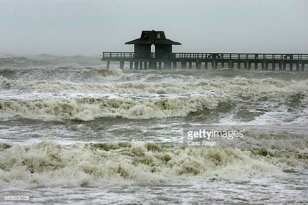 The Naples Pier is seen amongst the heavy waves as Hurricane Wilma passes through October 24 2005 in Naples Florida Wilma slammed into the South...