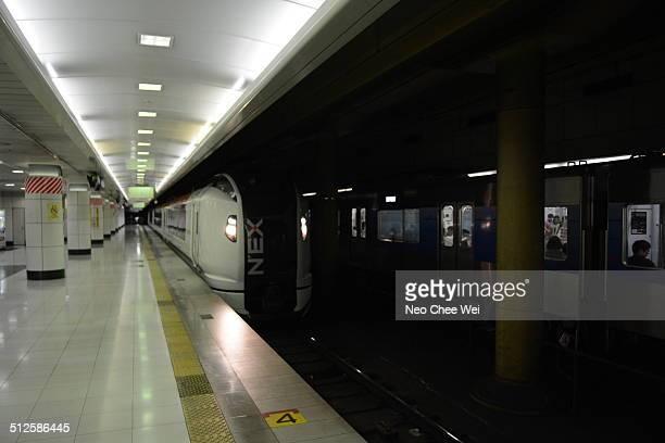 The Narita Express approaching the train station in Narita Airport Tokyo Japan
