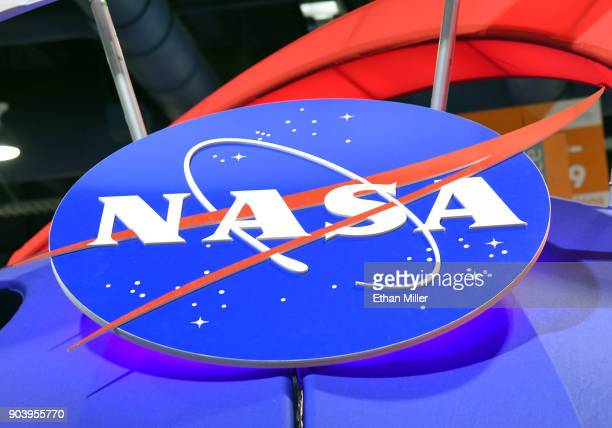 The NASA logo is displayed at the agency's booth during CES 2018 at the Las Vegas Convention Center on January 11 2018 in Las Vegas Nevada CES the...