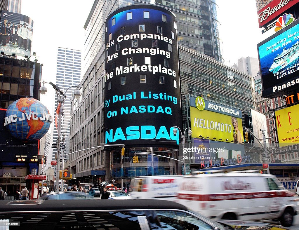 Six blue chip companies will list on nasdaq and nyse photos and the nasdaq electronic times square billboard displays the message that six blue chip companies that biocorpaavc Choice Image
