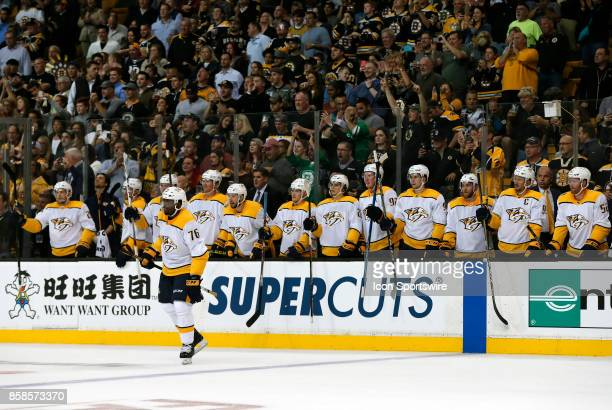 The Nashville bench applauds a fight during an NHL game between the Boston Bruins and the Nashville Predators on October 5 at TD Garden in Boston...