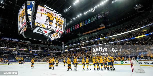 The Nashville Predators celebrate a 5-0 win against the Carolina Hurricanes to finish the regular season at Bridgestone Arena on May 10, 2021 in...