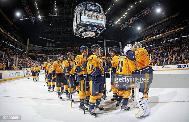 The Nashville Predators celebrate a 51 win against the Montreal Canadiens during an NHL game at Bridgestone Arena on December 21 2015 in Nashville...