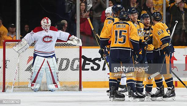 The Nashville Predators celebrate a goal against the Montreal Canadiens during an NHL game at Bridgestone Arena on December 21 2015 in Nashville...