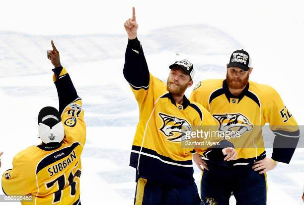 The Nashville Predators celebrate after defeating the Anaheim Ducks 6 to 3 in Game Six of the Western Conference Final during the 2017 Stanley Cup...