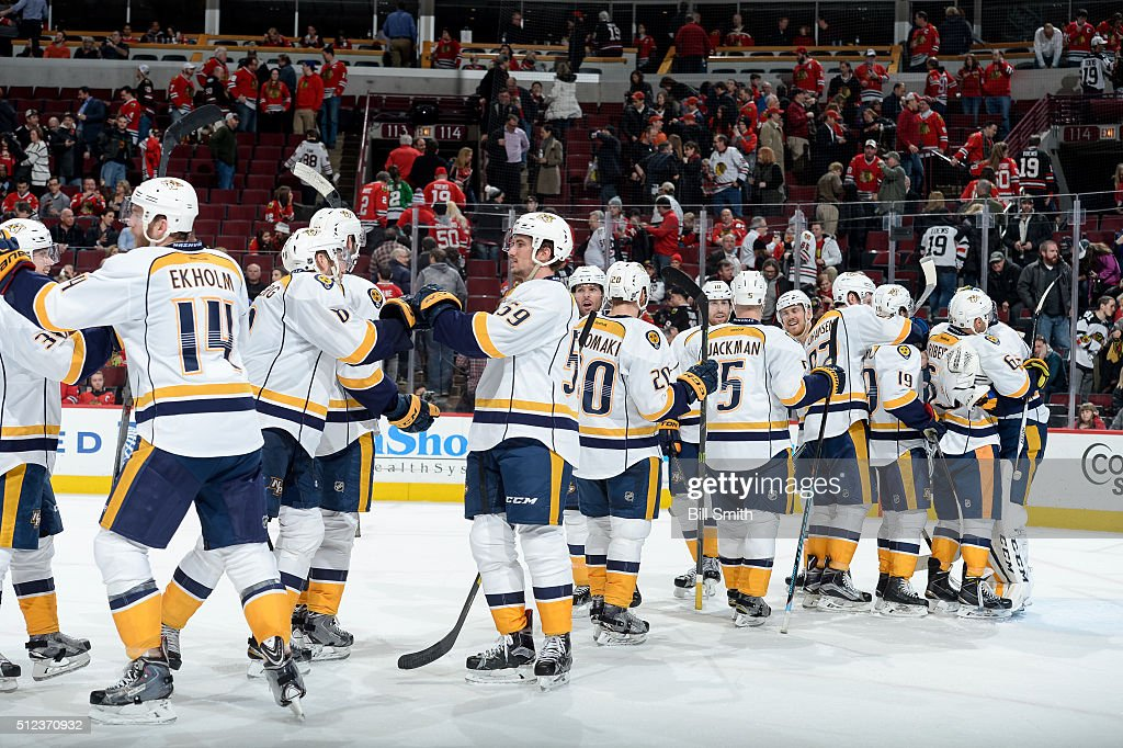 The Nashville Predators celebrate their 3 to 1 victory over the Chicago Blackhawks during the NHL game at the United Center on February 25, 2016 in Chicago, Illinois.