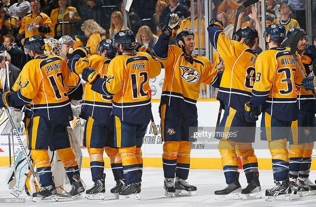 The Nashville Predators celebrates an overtime win against the Winnipeg Jets at Bridgestone Arena on October 24, 2013 in Nashville, Tennessee.