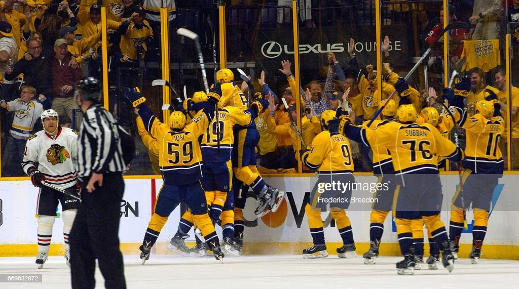 The Nashville Predators charge the ice after defeating the Chicago Blackhawks in overtime in Game Three of the Western Conference First Round during the 2017 NHL Stanley Cup Playoffs at Bridgestone Arena on April 17, 2017 in Nashville, Tennessee.