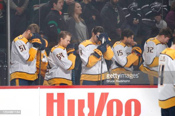 The Nashville Predators observe a moment of silence for the Nashville tornado prior to the start of the game against the Minnesota Wild at the Xcel...