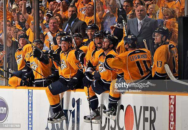 The Nashville Predators react in the final seconds of Game Five of the Western Conference Quarterfinals moments before eliminating the Detroit Red...