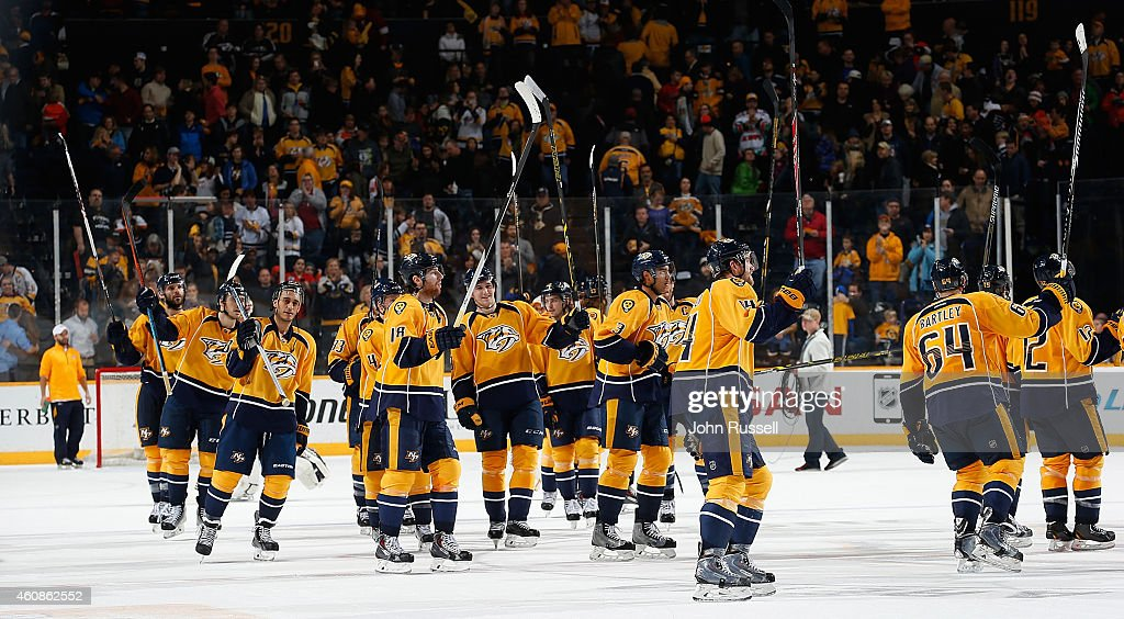 The Nashville Predators salute the fans after a win against the Philadelphia Flyers at Bridgestone Arena on December 27, 2014 in Nashville, Tennessee.