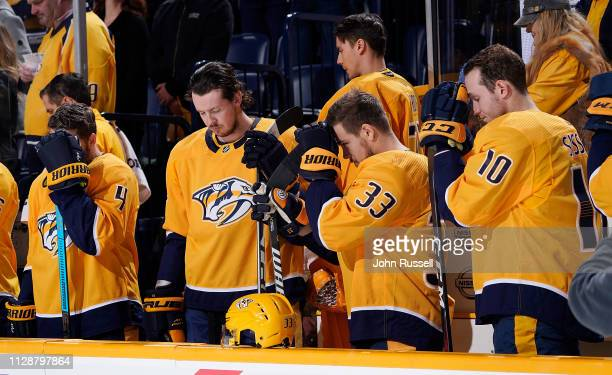 The Nashville Predators take a moment in silence to honor the late hockey great Ted Lindsay prior to an NHL game against the Minnesota Wild at...