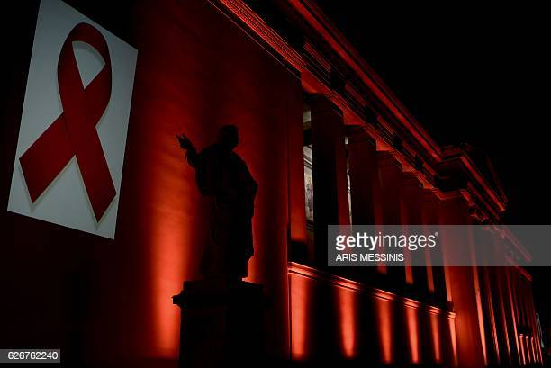 The National and Kapodistrian University of Athens is illuminated with a red light by the Hellenic Center for Disease Control Prevention on the eve...