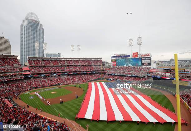 The national anthem before the start of the Philadelphia Phillies game against the Cincinnati Reds on Opening Day for both team at Great American...