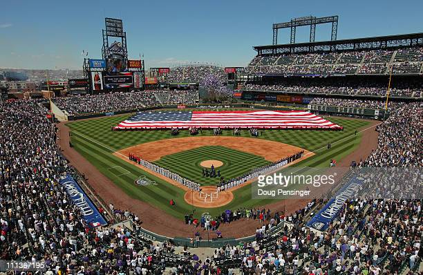 The National Anthem is observed prior to the game as the Colorado Rockies host the Arizona Diamondbacks during Opening Day at Coors Field on April 1...