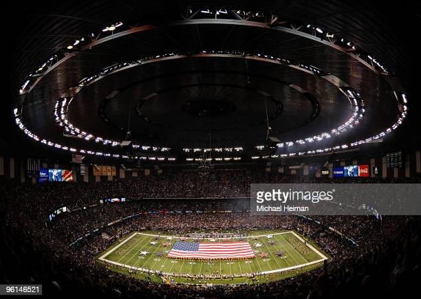 The National Anthem is performed as a flag is displayed on the field before the NFC Championship Game between the New Orleans Saints and the...
