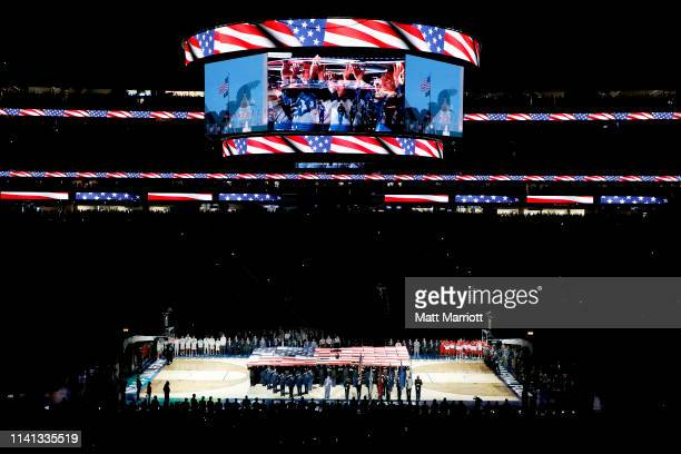 The National Anthem is performed before the game between the Virginia Cavaliers and the Texas Tech Red Raiders in the 2019 NCAA men's Final Four...