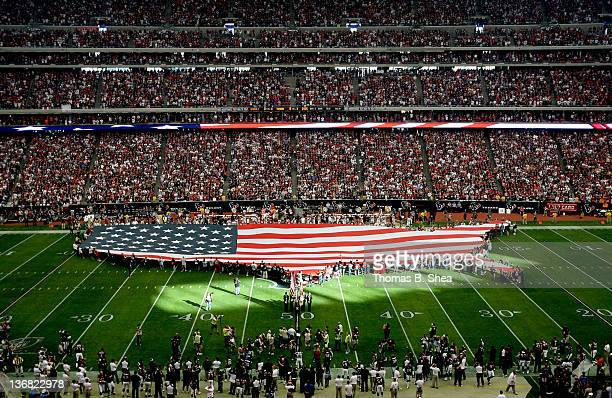The National Anthem is played before the 2012 AFC Wild Card Playoff game between the Cincinnati Bengals and Houston Texans at Reliant Stadium on...