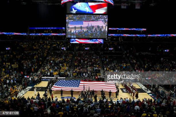The National Anthem is preformed prior to the start of the Saint Joseph's Hawks and VCU Rams championship game of the men's Atlantic 10 tournament on...