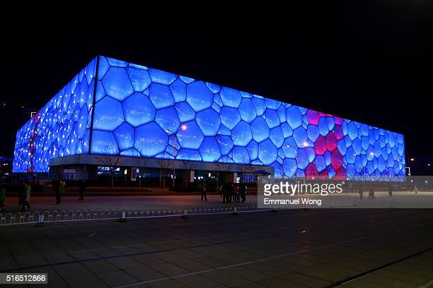 The National Aquatics Center also known as the 'Water Cube' lights are on before it is darkened for one hour to mark Earth Hour on March 19 2016 in...