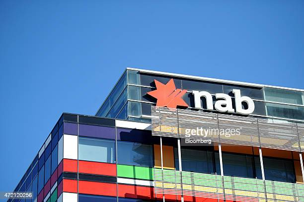 The National Australia Bank Ltd logo is displayed atop the company's headquarters in Melbourne Australia on Friday May 1 2015 NAB is scheduled to...