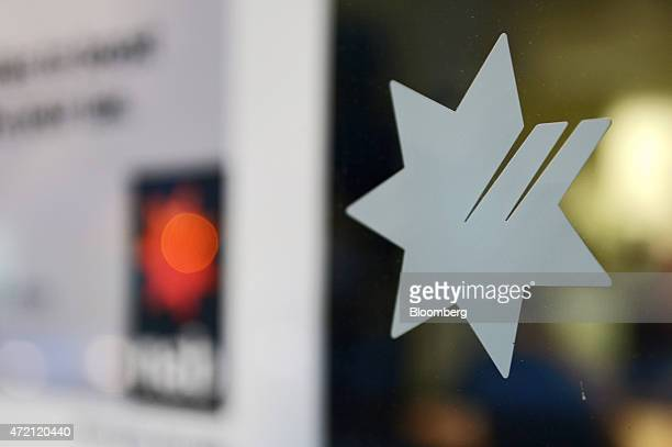 The National Australia Bank Ltd logo is displayed on the window of a bank branch in Melbourne Australia on Friday May 1 2015 NAB is scheduled to...